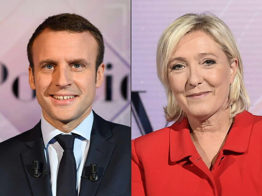 (COMBO) (FILES) This combination of file pictures created on April 25, 2017 in Paris shows a December 11, 2016 photo of French presidential election candidate for the En Marche ! movement Emmanuel Macron (L) and a September 11, 2016 of French presidential election candidate for the far-right Front National (FN) party Marine Le Pen, both in televisions studios in La Plaine-Saint-Denis. Centrist Emmanuel Macron topped the initial polls on April 23, 2017 and looked well on course to beat far-right candidate Marine Le Pen in a run-off on May 7. / AFP PHOTO / Eric FEFERBERG AND MIGUEL MEDINAERIC FEFERBERG,MIGUEL MEDINA/AFP/Getty Images