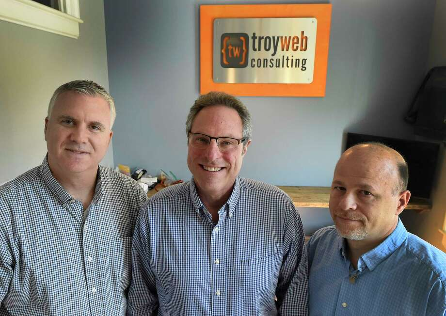 Top members of the company; Anthony Debonis, Director of Applications and Development, left;  Mark Poskanzer, Director of Business Development, center;  Jon Briccetti, President and CEO in the offices of Troy Web Consulting Tuesday April 18, 2017 in Troy, N.Y. (Skip Dickstein/Times Union) Photo: SKIP DICKSTEIN / 20040294A