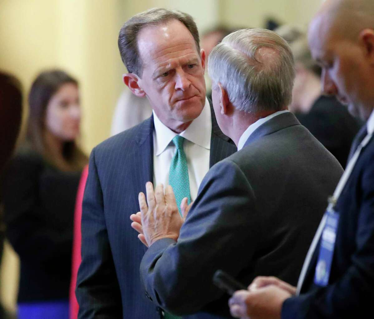 Sen. Pat Toomey, R-Pa., left, and Sen. Lindsey Graham, R-S.C. talk on Capitol Hill in Washington, Tuesday, April 25, 2017. Graham says he emerged from a dinner meeting with Donald Trump confident the president will not allow North Korea to build a nuclear-tipped missile capable of striking the United States. (AP Photo/Alex Brandon)