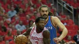 Houston Rockets guard Patrick Beverley (2) drives to the basket against Oklahoma City Thunder center Steven Adams (12) in the first half of Game 5 of a Western Conference quarterfinals of the 2017 NBA playoffs, April 24, 2017, in Houston.