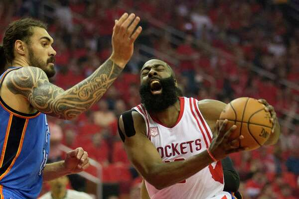 Houston Rockets guard James Harden (13) drives to the basket against Oklahoma City Thunder center Steven Adams (12) in the first half of Game 5 of a Western Conference quarterfinals of the 2017 NBA playoffs, April 24, 2017, in Houston.