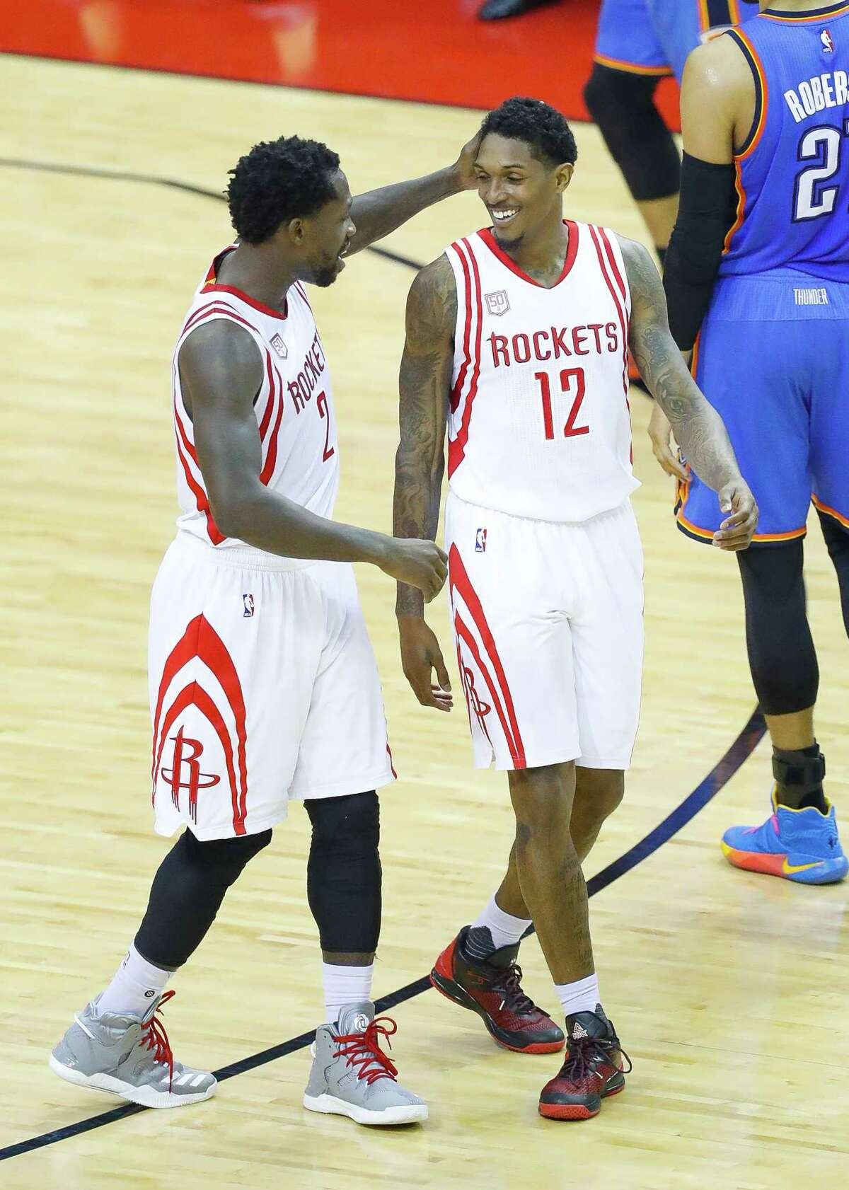 Houston Rockets guard Patrick Beverley (2) congratulates Houston Rockets guard Lou Williams (12) during the first half of Game 5 of a Western Conference quarterfinals of the 2017 NBA playoffs, Tuesday, April 24, 2017, at Toyota Center in Houston.