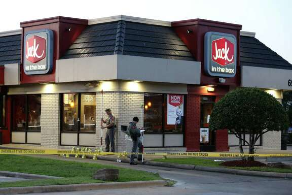 Authorities investigate the scene on Texas 6 where a multi-agency task force stopped an attempted armed robbery, fatally shooting one of the suspects and injuring two others late Monday.