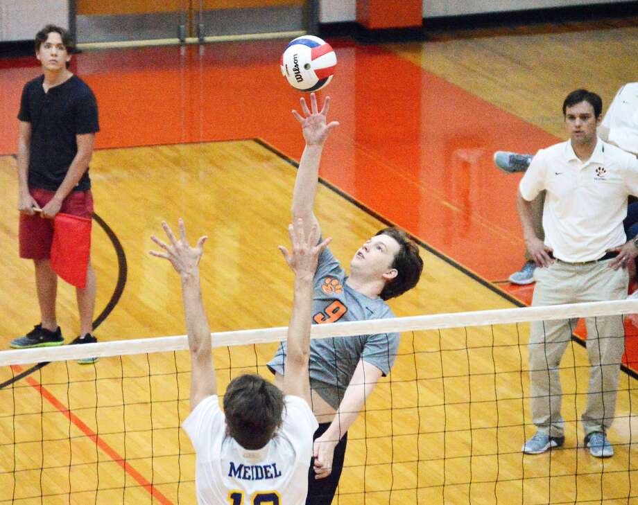Edwardsville outside hitter Eric Brammeier goes up for a kill attempt against O'Fallon in the first game of Tuesday's Southwestern Conference match.