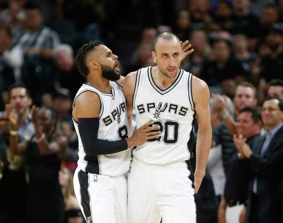 SAN ANTONIO,TX - APRIL 25 :  Patty Mills #8 of the San Antonio Spurs congratulates Manu Ginobili #20 of the San Antonio Spurs after a defensive effort against the Memphis Grizzlies in  Game Five of the Western Conference Quarterfinals during the 2017 NBA Playoffs at AT&T Center on April 25, 2017 in San Antonio, Texas.  NOTE TO USER: User expressly acknowledges and agrees that , by downloading and or using this photograph, User is consenting to the terms and conditions of the Getty Images License Agreement. Photo: Ronald Cortes, Getty Images / 2017 Getty Images
