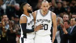 SAN ANTONIO,TX - APRIL 25 :  Patty Mills #8 of the San Antonio Spurs congratulates Manu Ginobili #20 of the San Antonio Spurs after a defensive effort against the Memphis Grizzlies in  Game Five of the Western Conference Quarterfinals during the 2017 NBA Playoffs at AT&T Center on April 25, 2017 in San Antonio, Texas.  NOTE TO USER: User expressly acknowledges and agrees that , by downloading and or using this photograph, User is consenting to the terms and conditions of the Getty Images License Agreement.