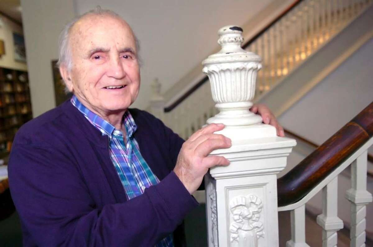 """Greenwich resident and nationally syndicated cartoonist Tony DiPreta, shown here in 2008 at the Greenwich Senior Center, died Wednesday, June 2, at age 88. The Stamford native is best known as the longtime successor artist of the popular comic strip """"Joe Palooka,"""" from 1959-84, and of the """"Rex Morgan, M.D."""" daily strip from 1994 through DiPreta's retirement in 2000."""