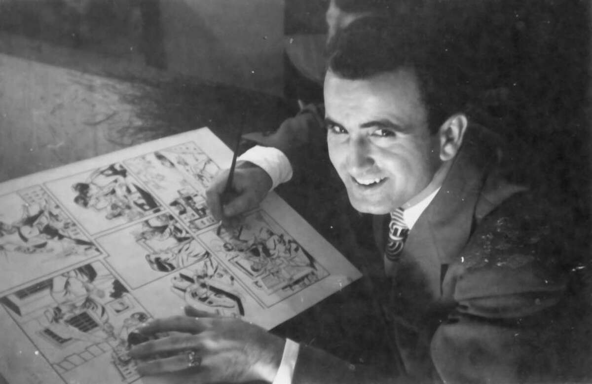"""Tony DiPreta works on his comic strips in a makeshift art studio (formerly a chicken coop) that he converted on his late mother Maria's property on in Stamford in this undated photo. DiPreta, a Greenwich resident who illustrated nationally syndicated comic strips """"Joe Palooka"""" and """"Rex Morgan, M.D.,"""" died Wednesday. He was 88."""