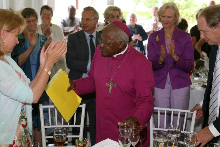 "1984 Nobel Peace Prize winner Archbishop Desmond Tutu returns to his seat after he spoke to parishoners and friends of Christ Church Greenwich during the church's ""Courage & Faith:  A Conversation Series"" Friday afternoon. Photo: David Ames, David Ames/For Greenwich Time / Greenwich Time"