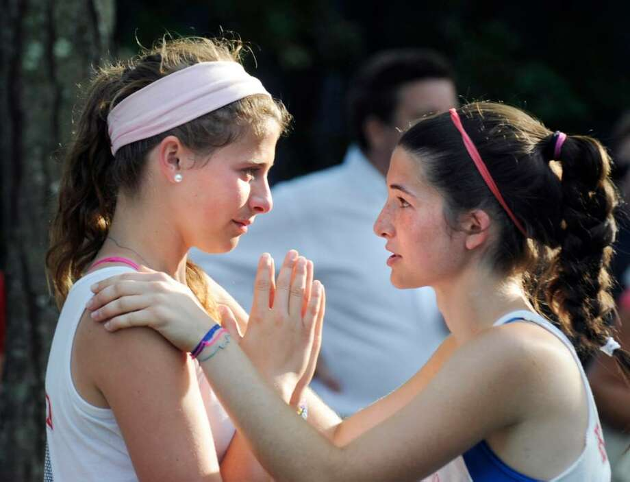 Greenwich High School doubles teammates, Katey Hopper, left and Lauren Daccache, right, console each other after losing the deciding in the State Class L Girls Tennis Championship against Fairfield Warde at Yale University, Friday, June 4, 2010. Photo: Bob Luckey / Greenwich Time