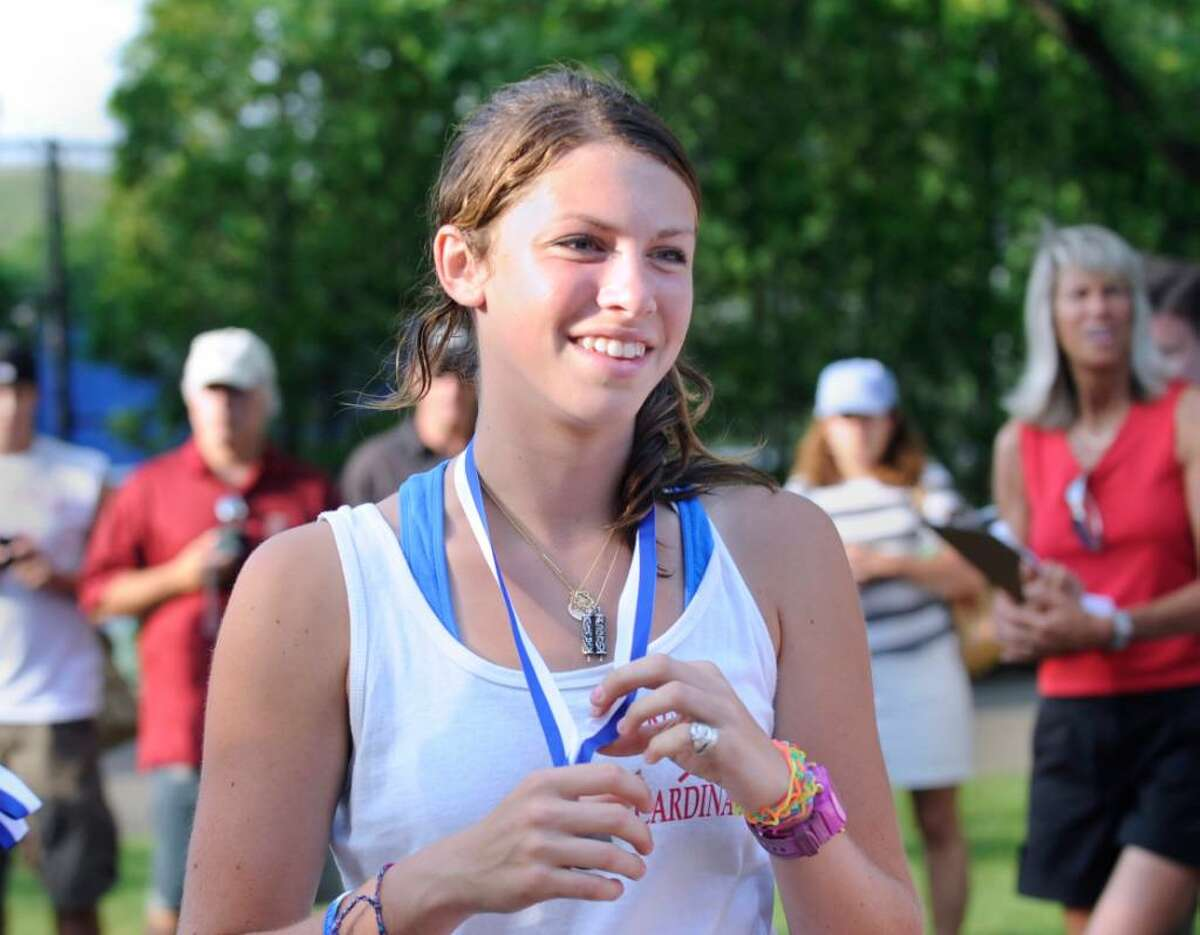 Sam Stone of Greenwich High School smiles as she receives her runner's up medal after the finish of the State Class L Championship match against Fairfield Warde High School in which GHS lost, at Yale University, Friday, June 4, 2010.
