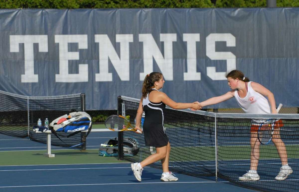 Haley Wolf of Fairfield Warde High School, left, shakes hands with Danielle Cepelewicz of Greenwich High School, right, after, Cepelewicz won the match at Yale University, Friday, June 4, 2010, during the Girls State Class L Championship. Fairfield Warde beat GHS to win the Championship.