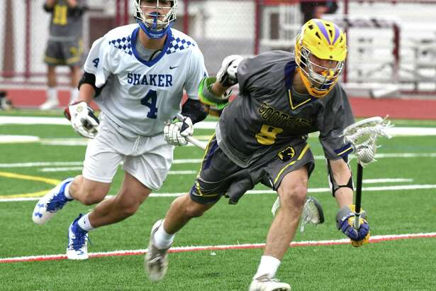 Shaker High School's Nick Pepe, left, chases down Ballston Spa's Alex Yerou, right, during a boy's lacrosse game at Watervliet High School on Tuesday, April 25, 2017, in Watervliet, N.Y. (Will Waldron/Times Union)