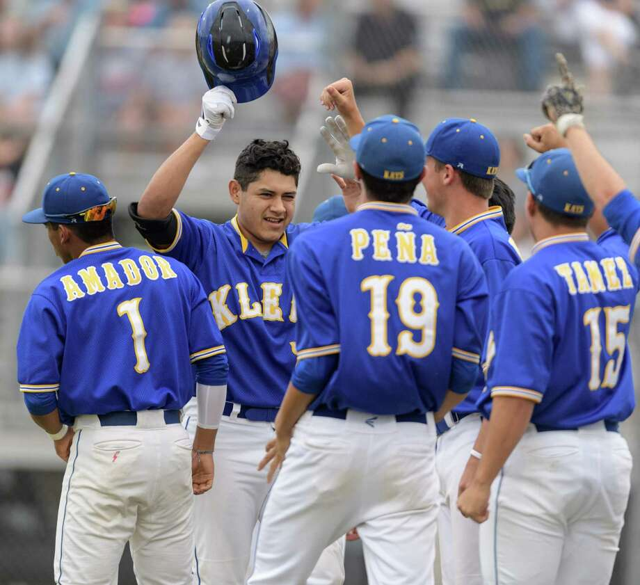 Jose Gonzalez, second from left, helped Klein build a lead with a home run, but Klein Collins showed tenacity in pulling out an 8-7 victory that left the teams tied for the district lead. Photo: Wilf Thorne / © 2017 Houston Chronicle