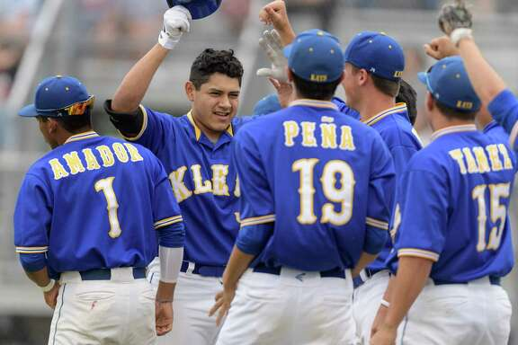 Jose Gonzalez, second from left, helped Klein build a lead with a home run, but Klein Collins showed tenacity in pulling out an 8-7 victory that left the teams tied for the district lead.