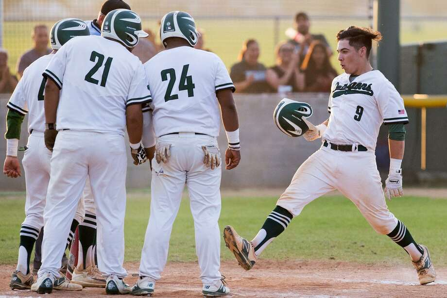 Southwest's Nate Aguilar (right) is greeted by teammates after his third-inning grand slam. Photo: Marvin Pfeiffer / San Antonio Express-News / Express-News 2017