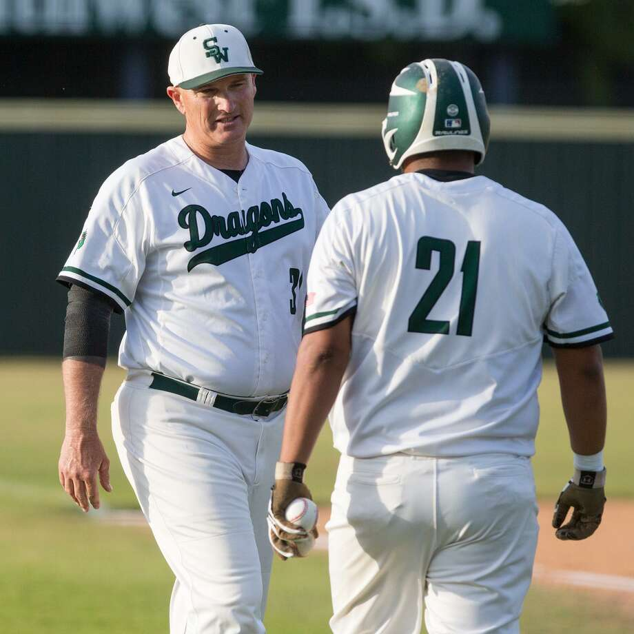 Southwest coach Bobby Behnsch (left) talks to Luis Padilla during a District 29-6A baseball game against South San on April 25, 2017. Photo: Marvin Pfeiffer /San Antonio Express-News / Express-News 2017