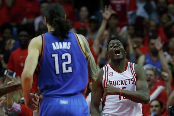 Clint Capela enjoys the aftermath of dunking over Thunder guard Russell Westbrook.