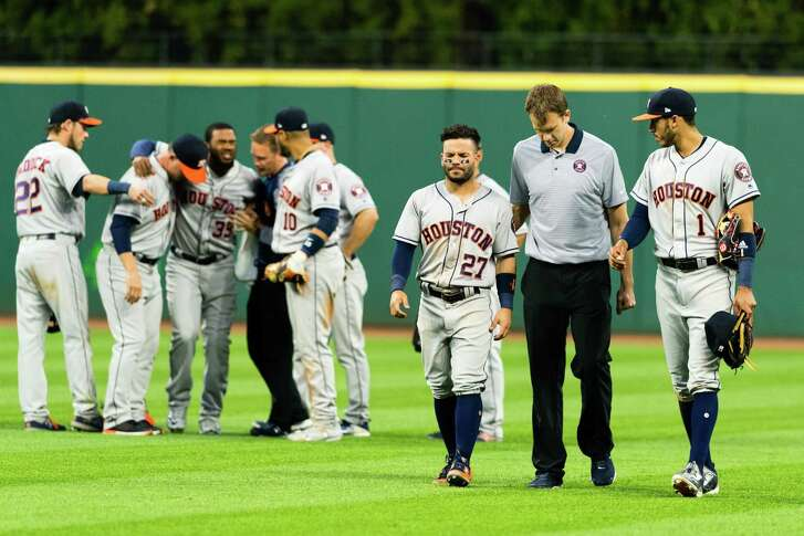 CLEVELAND, OH - APRIL 25: Teammates help Teoscar Hernandez #35 and Jose Altuve #27 of the Houston Astros off the field after the two collided on a fly ball hit by Yan Gomes #7 of the Cleveland Indians during the eighth inning at Progressive Field on April 25, 2017 in Cleveland, Ohio.