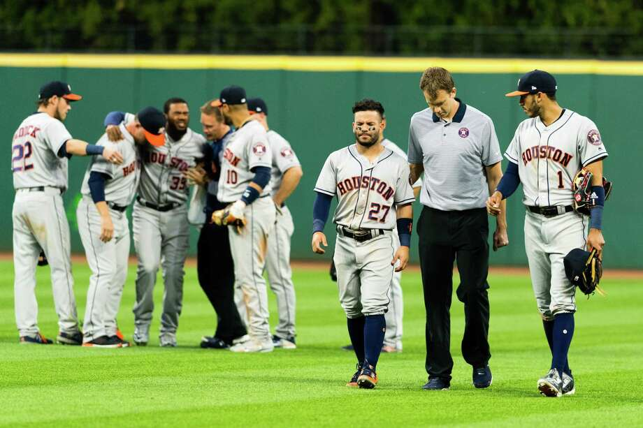 CLEVELAND, OH - APRIL 25: Teammates help Teoscar Hernandez #35 and Jose Altuve #27 of the Houston Astros off the field after the two collided on a fly ball hit by Yan Gomes #7 of the Cleveland Indians during the eighth inning at Progressive Field on April 25, 2017 in Cleveland, Ohio. Photo: Jason Miller, Getty Images / 2017 Getty Images