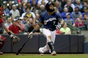 MILWAUKEE, WI - APRIL 25:  Eric Thames #7 of the Milwaukee Brewers hits a home run in the sixth inning against the Cincinnati Reds at Miller Park on April 25, 2017 in Milwaukee, Wisconsin. (Photo by Dylan Buell/Getty Images) ORG XMIT: 700010522