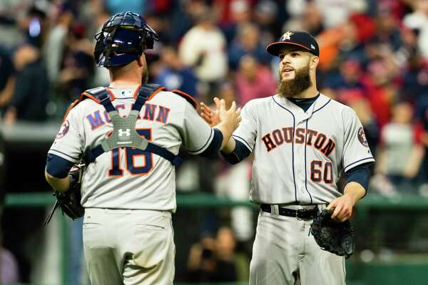 CLEVELAND, OH - APRIL 25: Catcher Brian McCann #16 celebrates with starting pitcher Dallas Keuchel #60 of the Houston Astros after Kuechel pitched a complete game to defeat the Cleveland Indians at Progressive Field on April 25, 2017 in Cleveland, Ohio. The Astros defeated the Indians 4-2.