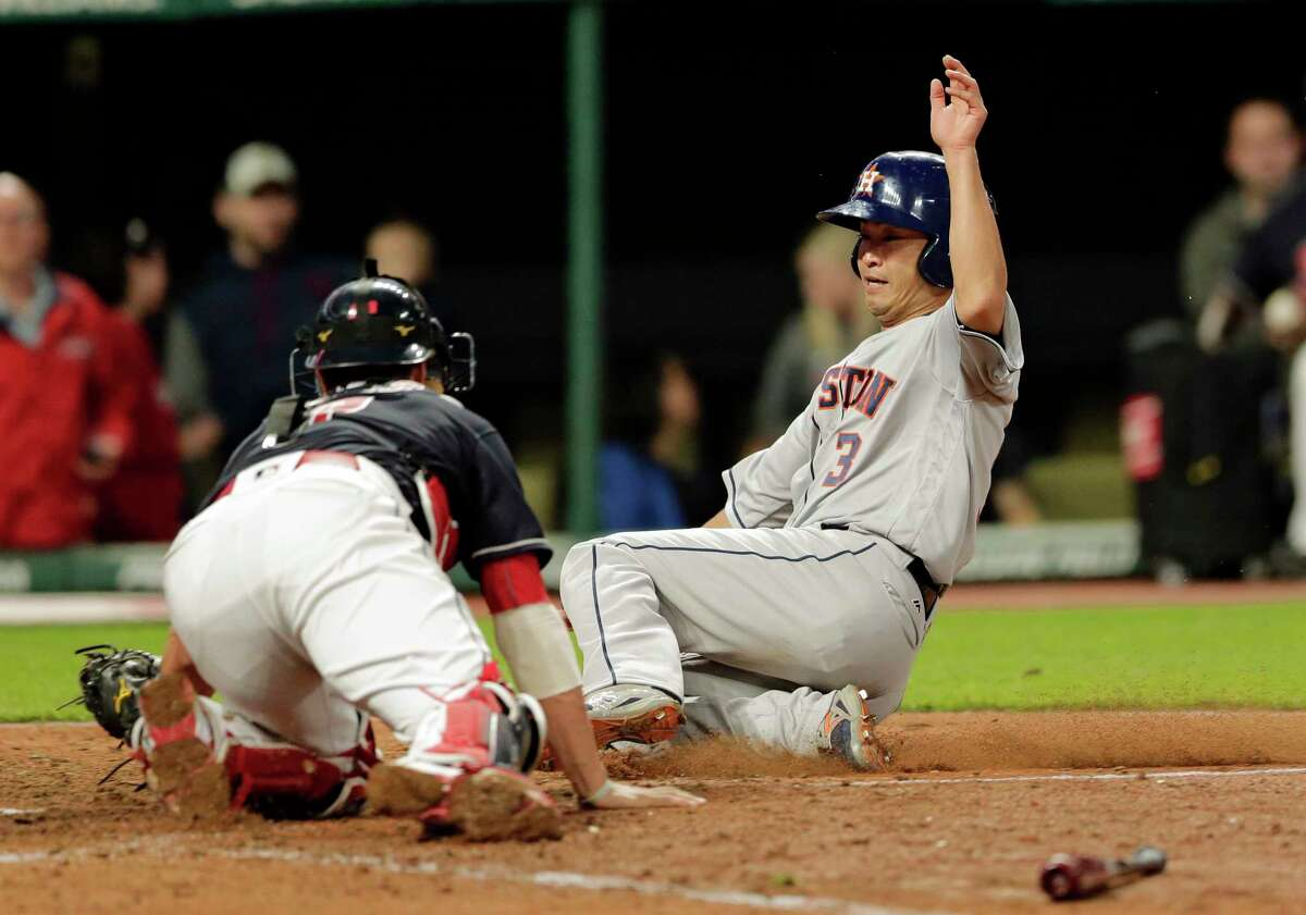 Houston Astros' Norichika Aoki, right, is tagged out at home plate by Cleveland Indians catcher Yan Gomes in the ninth inning of a baseball game, Tuesday, April 25, 2017, in Cleveland. Aoki tried to score from third base on a line drive by George Springer. (AP Photo/Tony Dejak)