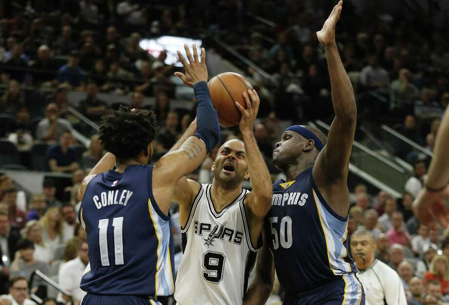 Spurs' Tony Parker attempts to drive between theMemphis Grizzlies' Mike Conley (11) and Zach Randolph (50) during Game 5 of the Western Conference playoffs at the AT&T Center on April 25, 2017. Photo: Kin Man Hui /San Antonio Express-News / ©2017 San Antonio Express-News