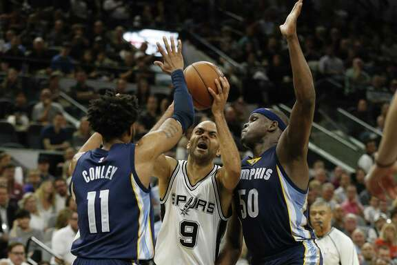 Spurs' Tony Parker attempts to drive between theMemphis Grizzlies' Mike Conley (11) and Zach Randolph (50) during Game 5 of the Western Conference playoffs at the AT&T Center on April 25, 2017.