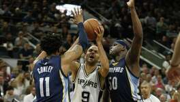 Spurs' Tony Parker (09) attempt to drive between Memphis Grizzlies' Mike Conley (11) and Zach Randolph (50) during Game 5 of the Western Conference playoffs at the AT&T Center on Tuesday, Apr. 25, 2017.(Kin Man Hui/San Antonio Express-News)