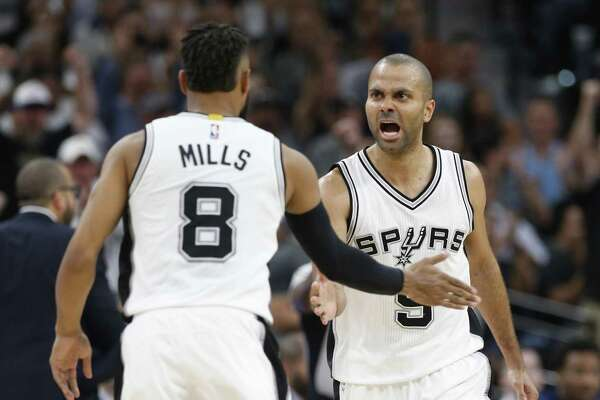 Spurs' Tony Parker (09) reacts with Patty Mills (08) after Mills sinks a three-pointer against the Memphis Grizzlies during Game 5 of the Western Conference playoffs at the AT&T Center on Tuesday, Apr. 25, 2017. Spurs take Game 5, 116-103, over the Grizzlies. (Kin Man Hui/San Antonio Express-News)