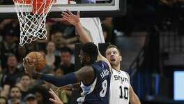 Spurs' David Lee (10) and Danny Green (14) attempt to defend against the Memphis Grizzlies' James Ennis during Game 5 of the Western Conference playoffs at the AT&T Center on April 25, 2017.