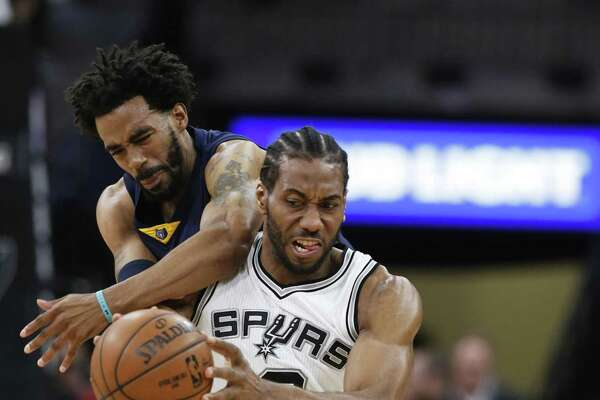 Spurs' Kawhi Leonard steals an inbound pass against the Memphis Grizzlies' Mike Conley during Game 5 of the Western Conference playoffs at the AT&T Center on April 25, 2017.