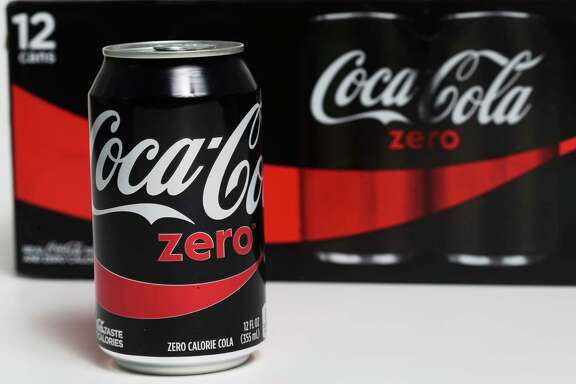 In this Friday, April 21, 2017, photo, a can of Coca-Cola Zero is arranged for a photo in Surfside, Fla. On Tuesday, April 25, 2017, The Coca-Cola Company reports earnings. (AP Photo/Wilfredo Lee)
