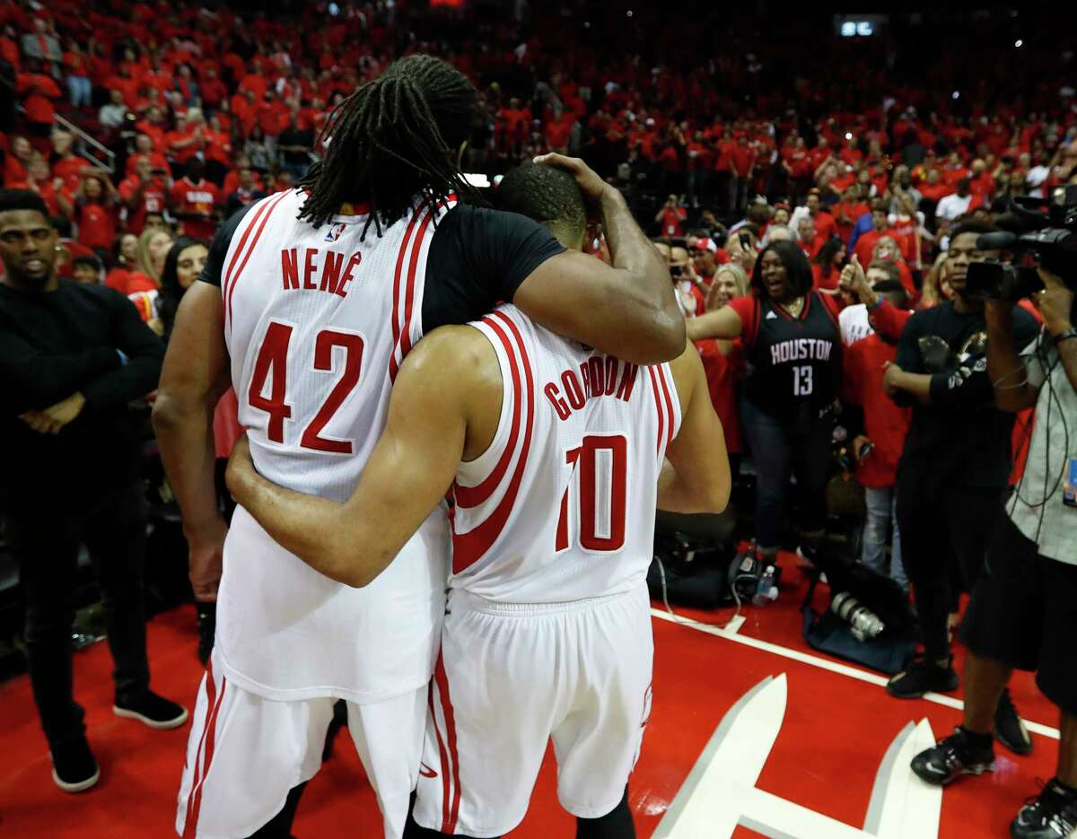 Houston Rockets center Nene Hilario (42) hugs guard Eric Gordon (10) after the Rockets beat Oklahoma City Thunder in Game 5 of a Western Conference quarterfinals of the 2017 NBA playoffs, April 24, 2017, in Houston.