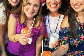 NEW: Mangonada madness is a new thing at Frontier Town for A Night in Old San Antonio at Fiesta 2017. Tastes like sherbet after a Tex-Mex dinner. Just ask Xochitl Davis, left, Marisa Cook, Sharon Frattalone and Xochitl Spearman.at A Night in Old San Antonio during Fiesta 2017.