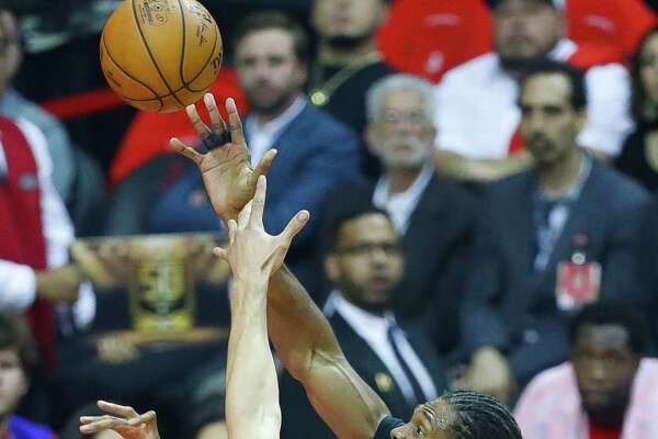The Rockets' Nene shoots over the Thunder's Steven Adams while providing another solid contribution off the bench with 14 points and seven rebounds