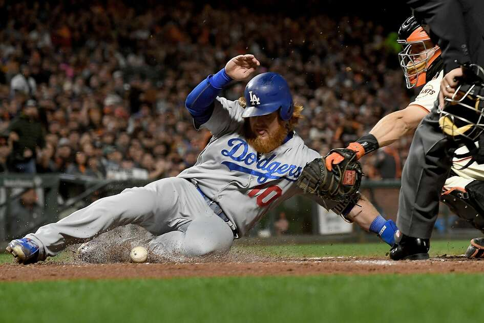 SAN FRANCISCO, CA - APRIL 25:  Justin Turner #10 of the Los Angeles Dodgers scores into home plate while kicking the ball away from catcher Nick Hundley #5 of the San Francisco Giants in the top of the fourth inning at AT&T Park on April 25, 2017 in San Francisco, California.  (Photo by Thearon W. Henderson/Getty Images)