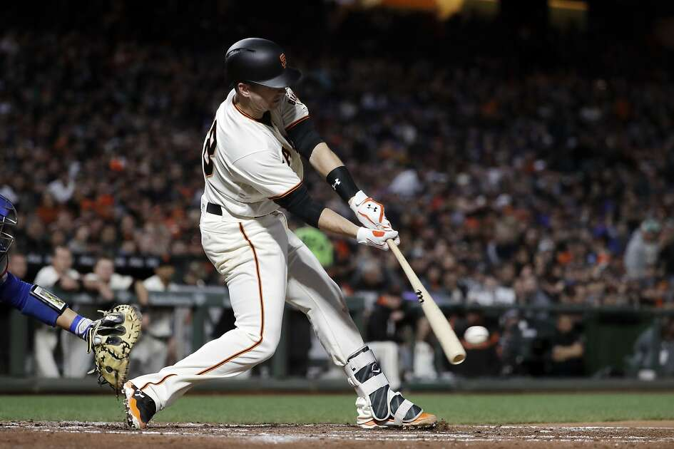San Francisco Giants' Buster Posey drives in a run with a single against the Los Angeles Dodgers during the third inning of a baseball game Tuesday, April 25, 2017, in San Francisco. (AP Photo/Marcio Jose Sanchez)