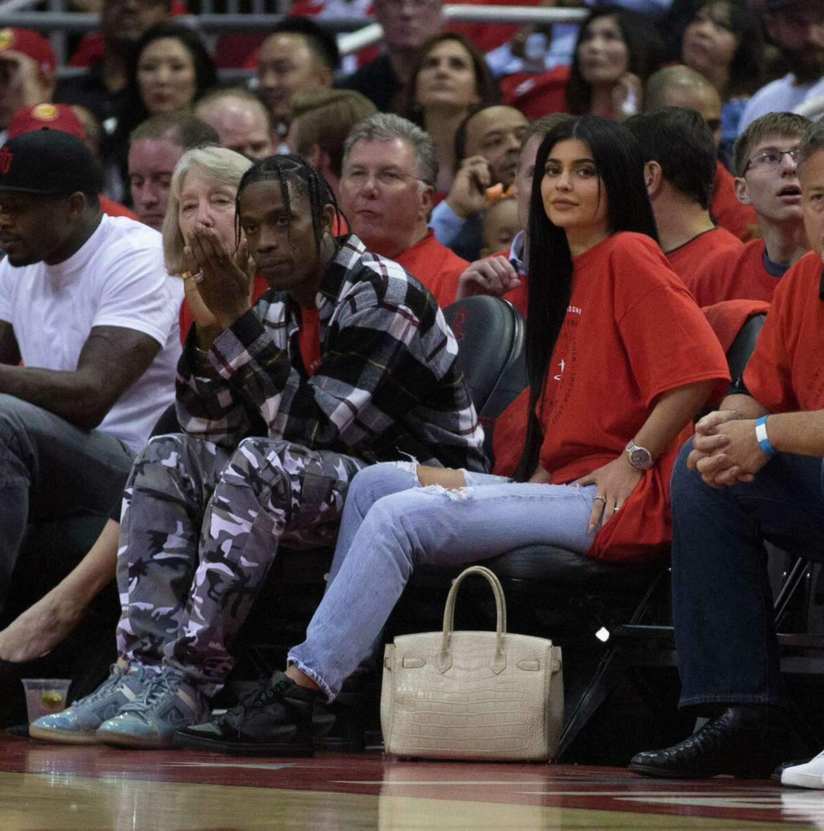 HOUSTON, TX - APRIL 25: Houston rapper Travis Scott and Kylie Jenner watch courtside during Game Five of the Western Conference Quarterfinals game of the 2017 NBA Playoffs at Toyota Center on April 25, 2017 in Houston, Texas. NOTE TO USER: User expressly acknowledges and agrees that, by downloading and/or using this photograph, user is consenting to the terms and conditions of the Getty Images License Agreement.