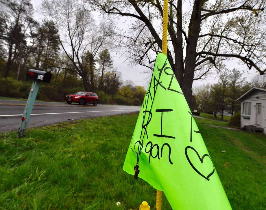 A memorial is seen on the side of River Road in Selkirk Wednesday morning, the day after an 18-year-old driver was killed and his passenger injured in a collision.  Photo: Skip Dickstein / Times Union