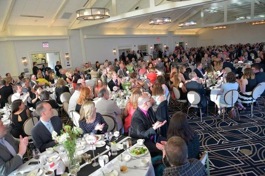The crowd reacts during the Cancer Services Spring Soiree at the Midland Country Club. / Robert Spears