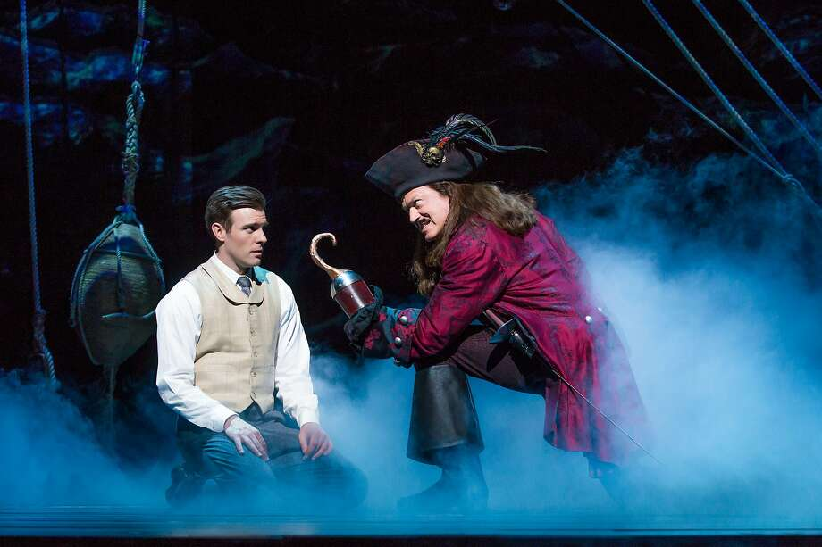 "Billy Harrigan Tighe as JM Barrie and Tom Hewitt as Captain Hook in the touring production of ""Finding Neverland."" Photo: Jeremy Daniel"
