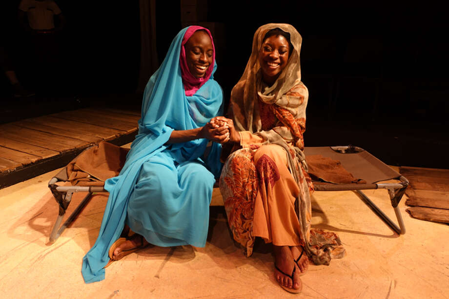 "Yemi Otulana as Hawa, left, and Precious Merenu as Hamida in Landing Theatre's ""In Darfur."""
