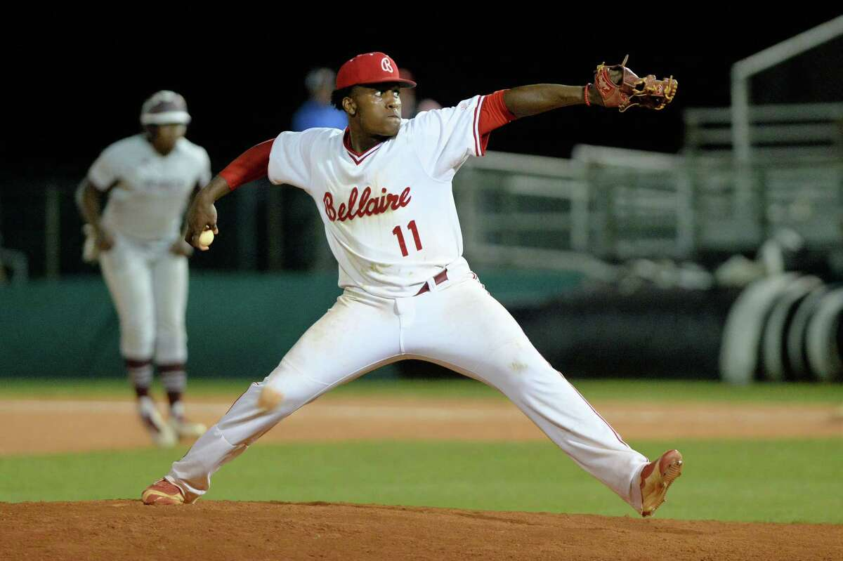 Reliver Ronald Brown (11) of Bellaire delivers a pitch for the final out of the seventh inning of a varsity baseball game between the Bellaire Cardinals and the Heights Bulldogs on Tuesday April 25, 2017 at Knoblauch Field, Houston, TX.