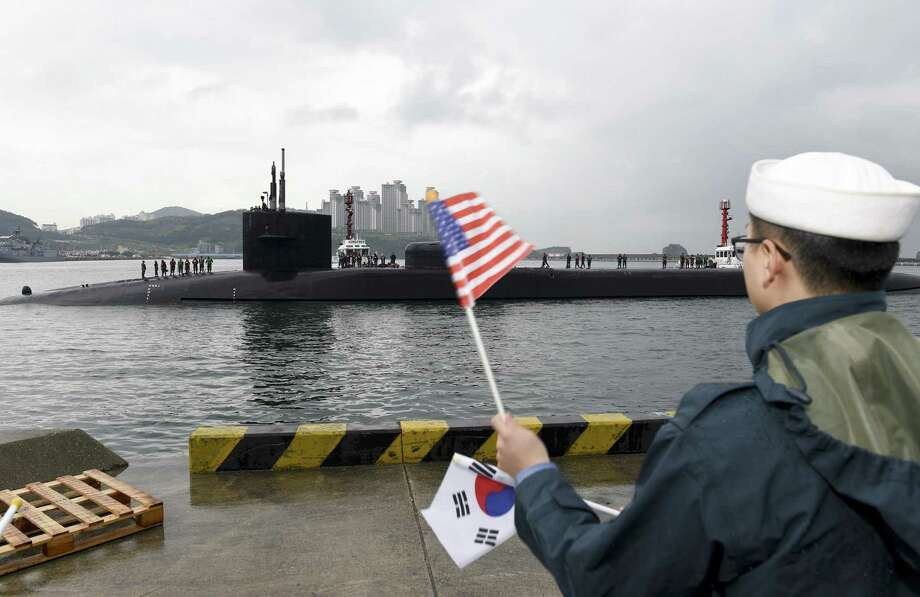 The USS Michigan, a nuclear-powered submarine, is greeted as it arrives in Busan, South Korea, for a scheduled port visit while doing routine patrols throughout the western Pacific. Photo: U.S. Navy Mass Communication Spc. 2nd Class Jermaine Ralliford /Getty Images / 2017 U.S. Navy