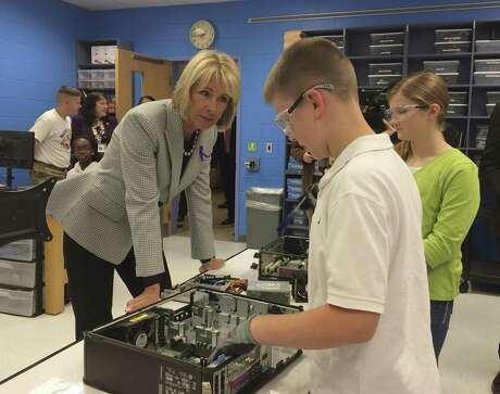 Education Secretary Betsy DeVos meets with stu dents at Ashland Elementary School in Manassas, Va.,  where many  parents serve in the military.