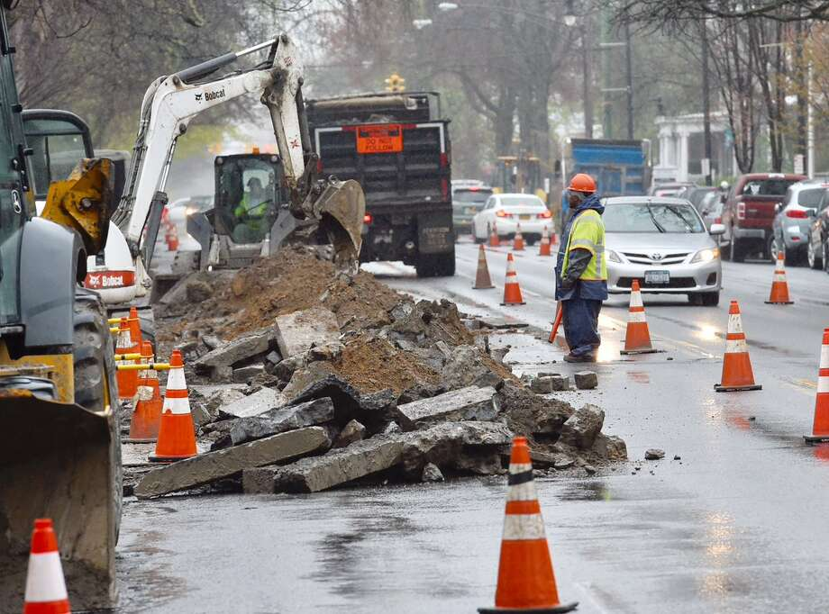 A National Grid crew works to install a new gas line Wednesday on Madison Avenue just west of Lake Avenue. Photo: Skip Dickstein / Times Union