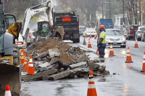 A National Grid crew works to install a new gas line Wednesday on Madison Avenue just west of Lake Avenue.