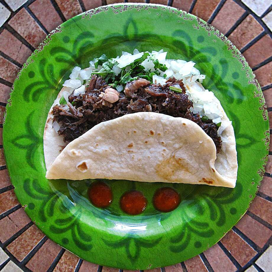 Barbacoa taco on a handmade flour tortilla from Dos Hermanos. Photo: Mike Sutter /San Antonio Express-News
